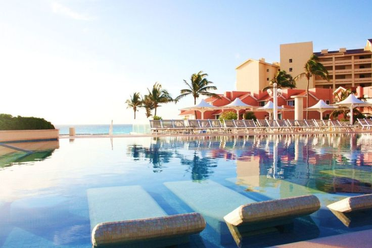 Omni Cancun Hotel & Villas, honeymooned here. Loved these tile lounge chairs in the water & waiters from the swim up bar!
