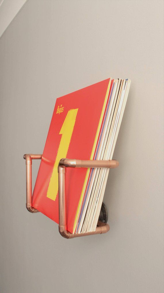 Wall mounted vinyl record holder – Handmade with industrial copper pipe and iron fittings