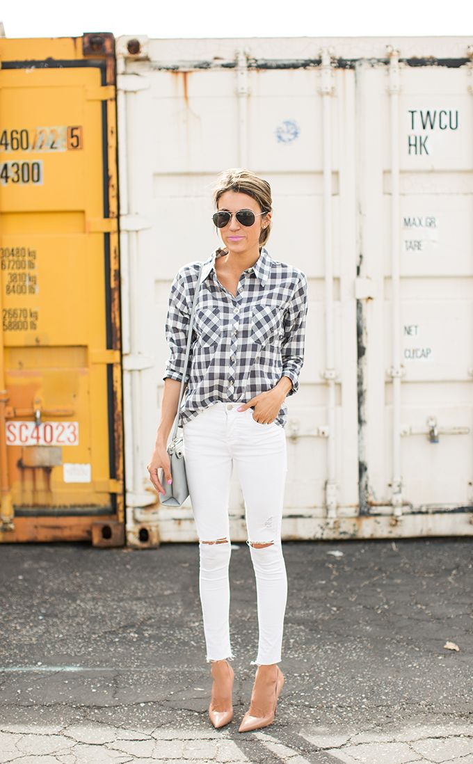 Street Style 2015: Christine Andrew is wearing a grey plaid shirt with a pair of white distressed jeans and nude heels