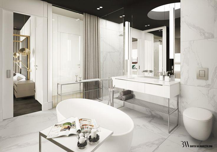Minimalistyczna łazienka z marmurową podłogą, wanną firmy Riho Bilbao, szklaną ścianą oddzielającą od holu. http://bartekwlodarczyk.com/
