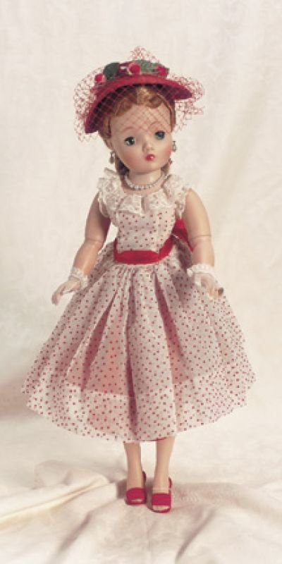 """Cissy in Red Polka Dot Afternoon Dress 20"""" (51 cm). Blonde hair with two spit curl bangs,side hair drawn into cluster of curls at nape of neck. Wearing white nylon party dress with red polka dots,fitted bodice with lace edging at neckline and sleeves,full skirt,red taffeta petticoat with tulle ruffle,red taffeta panties,red straw hat trimmed with rosebuds and leaves,red face veil,stockings,red sling heels,pearl necklace and teardrop pearl earrings,diamond ring,nylon gloves. Excellent…"""