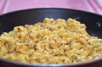 Eiernockerl mit Speck und Käse