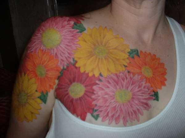 flower chest tattoos for women | Arm/Chest flowers tattoo ...