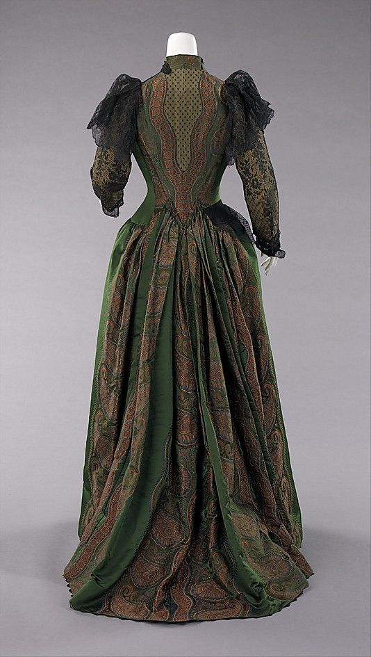 Green silk dress with stripes of paisley and black lace overlay (back), by Mme. Uoll Gross, American, 1889.