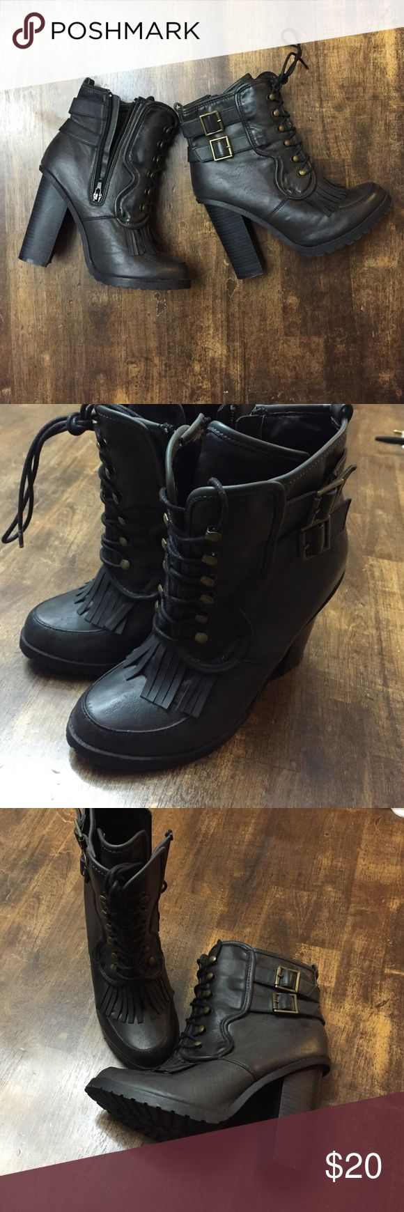 Trendy combat lace up style boots with fringe! Cute heeled boots. Lace up with fringe. Black like leather. In great condition, worn once. Little scuff on inside of the right boot, see photos. Shoes Combat & Moto Boots