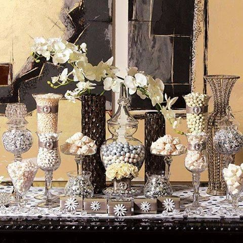 Silver, black and white sweets in a variety of containers create a stunning retro-glam candy buffet
