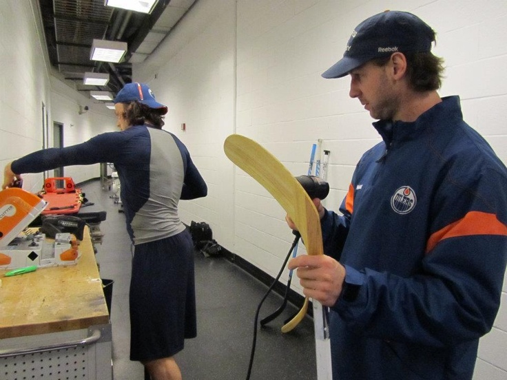 Ryan Smyth monitors Ryan Jones as he cuts his stick blade at Nationwide Arena in Columbus - January 17, 2012