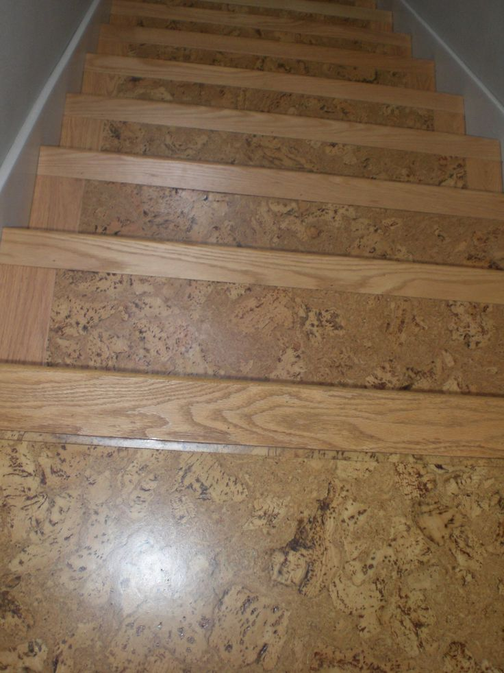 Cork on stairs with wooden stair nose pieces for the for Wood floor pieces