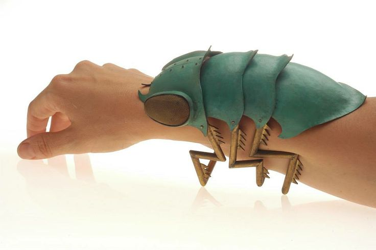 "Bracelet | Teresa Milheiro. ""Articulated Escamarao"". Brass and forged copper with patina.:"