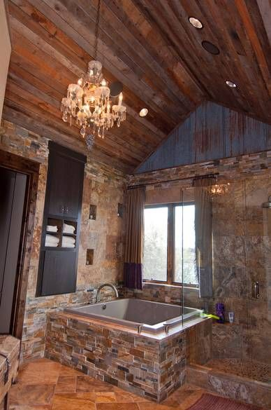 OOOH!  I really like this- the open-feel shower and the tub with the stone work.  Stacked stone square bathtub - Lodge feel
