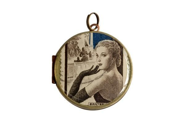 An elegant French postage stamp released in 1953.  The vintage locket is made from brass and copper and measures 30mm in diameter. The locket opens from the side and is capable of holding 2 of your most precious memories inside.