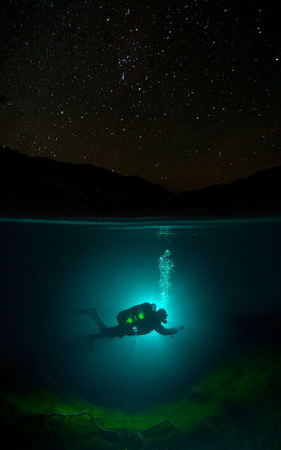 Diving under the stars.  Russia, Caucasus, Kabardino-Balkaria, Blue lake (Cherek-Kel).  by Viktor Lyagushkin.