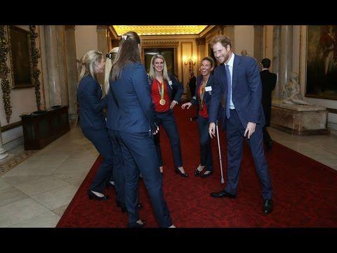 Prince Harry jokes around with British women's hockey team