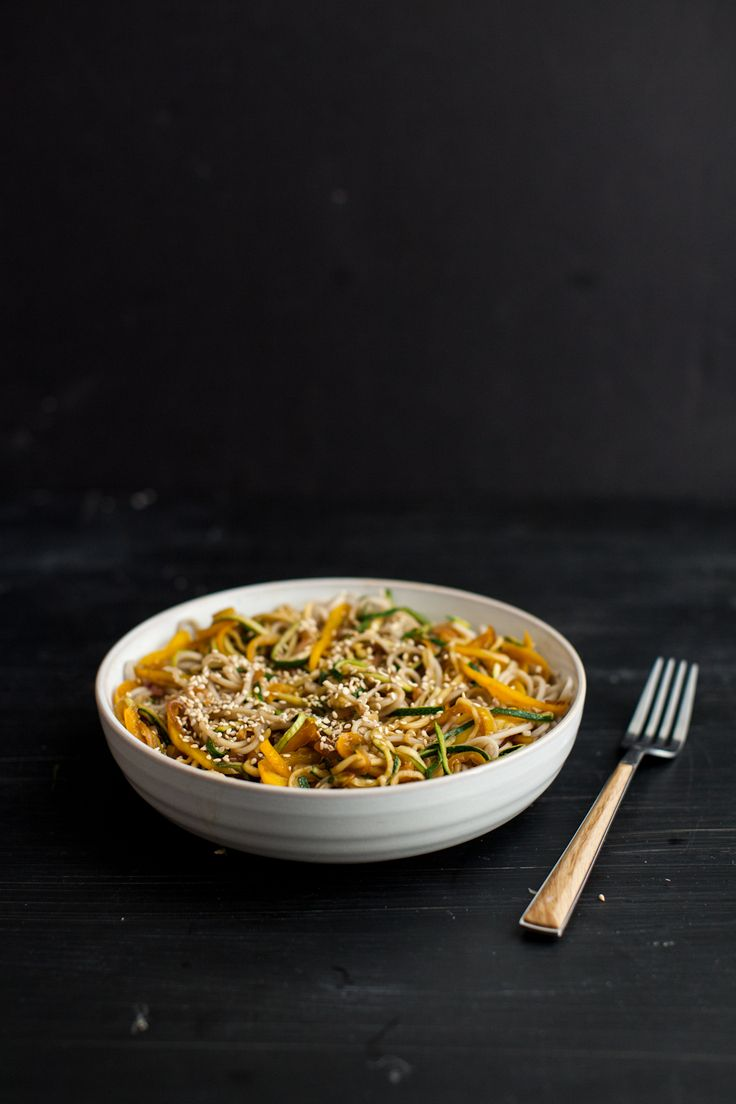 A simple lunch of shaved zucchini noodles and soba tossed with ginger and garlic. These noodles are perfect eaten fresh or packed for lunch the next day.