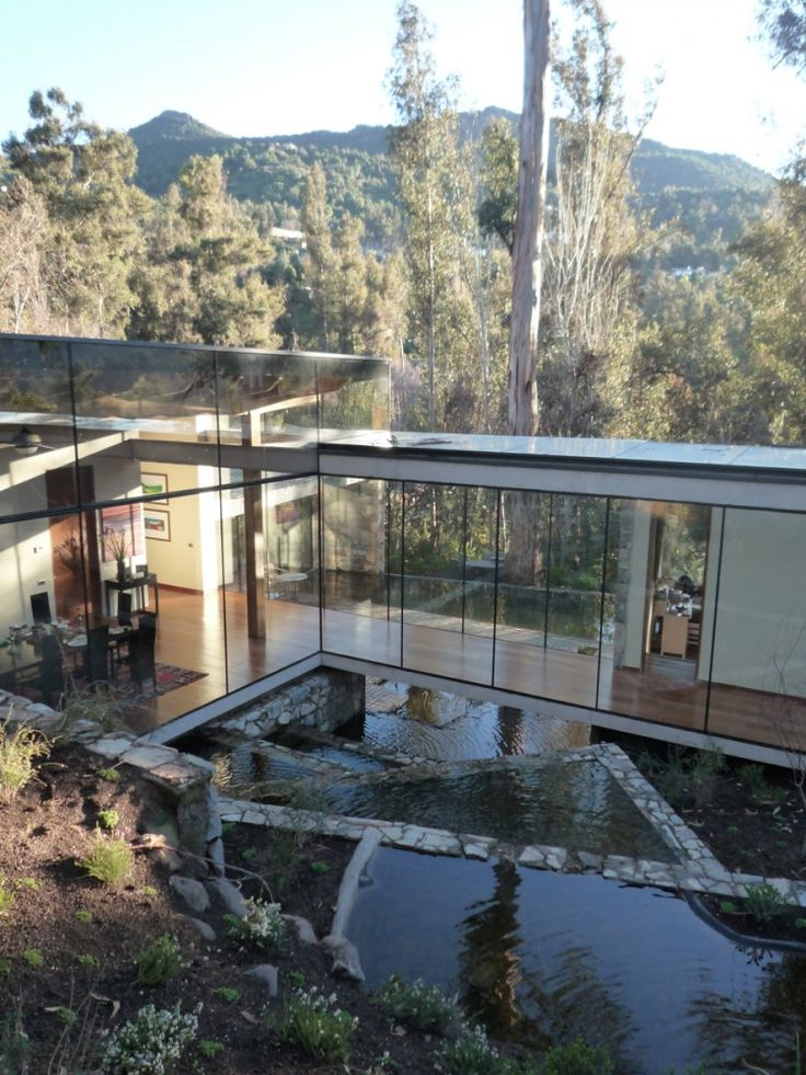 One of these is a pool. The other is an irrigation canal. Nice! In Lo Curro, Chile / Schmidt Arquitectos Asociados