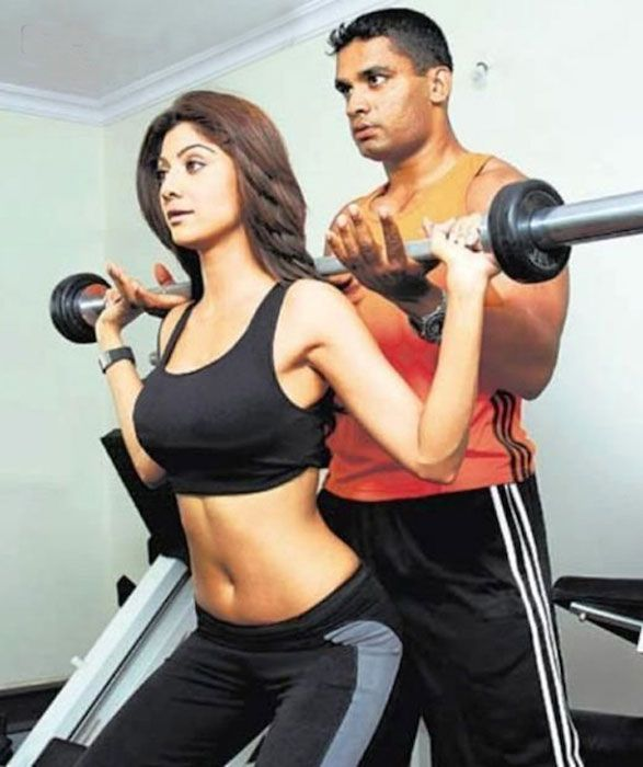 Indian actress, Shilpa Shetty working out with trainer....
