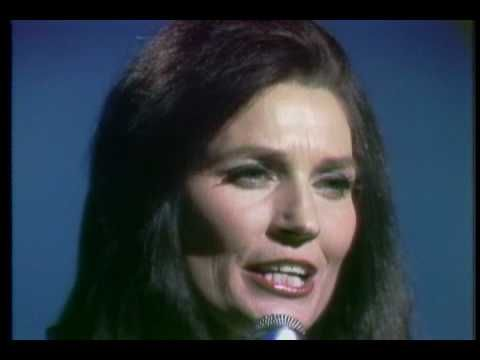 Ten Thousand Angels by Loretta Lynn.  One of my favorite songs . . . even Jesus had free will.