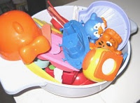 Plastic colander to store/drain bath toys {we do this and love it.  no moldy toys for us!}