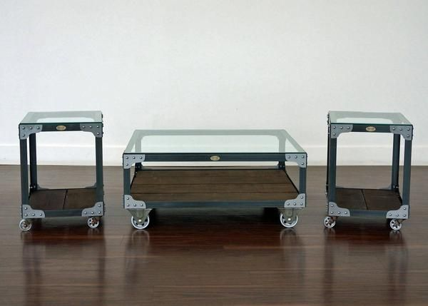 Matching Industrial Coffee Table  and two End Tables - A coffee table & two end tables from your choice of four steel finishes and six wood stains.   Made from steel angle iron and rough sawn white pine, fastened with rivets and brackets, all mounted on iron casters.   See link for further information. Duty Free.