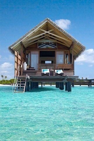 Bora Bora. I have been here but i want to definitely go back and stay in one of these huts!