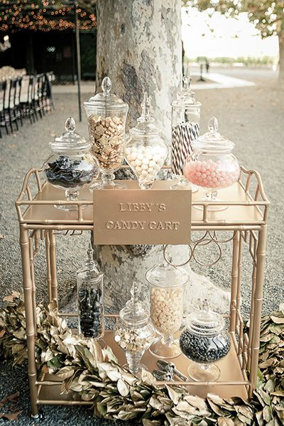 Bar carts can be used for more than just storing your favorite cocktail ingredients. Use one in your wedding as a candy cart, then repurpose in your home as a bar cart, side table, or whatever your heart desires.