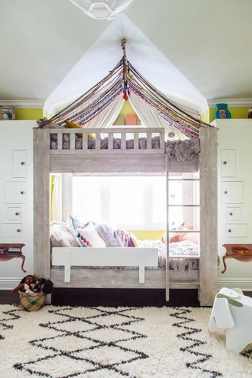 eclectic girls room features gray stained bunk beds accented with a canopy placed in front - Transitional Canopy Decorating