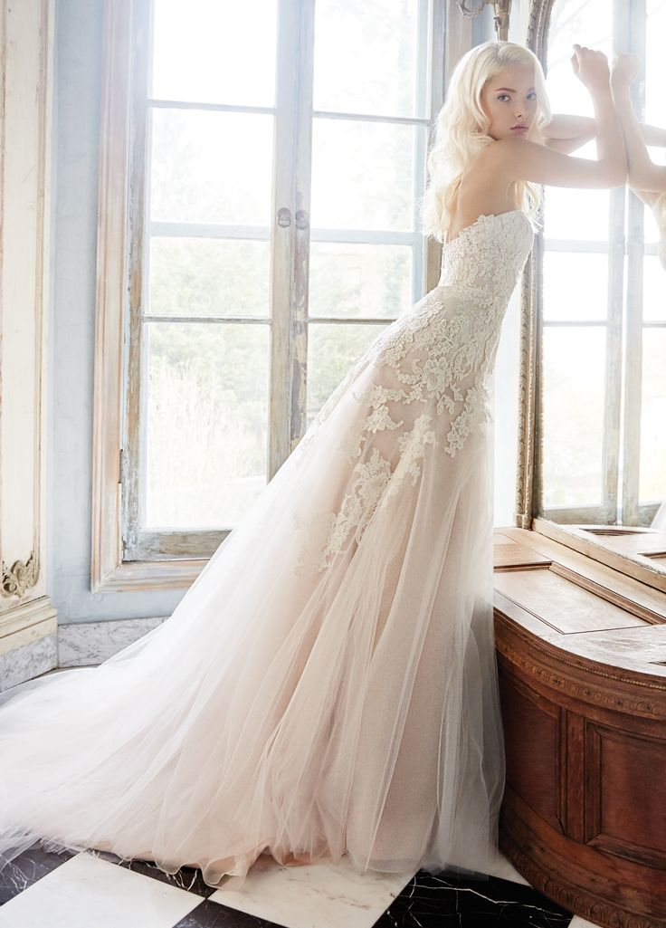 Ivory / Cashmere tulle modified A-line bridal gown with a sweetheart neckline and Alencon Lace placed throughout.