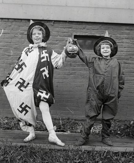 Oct 25,1918. Before Hitler ruined it, the swastika was a positive symbol with a very, very long history.  This is a photo of two kids before a Halloween dance on October 25, 1918.