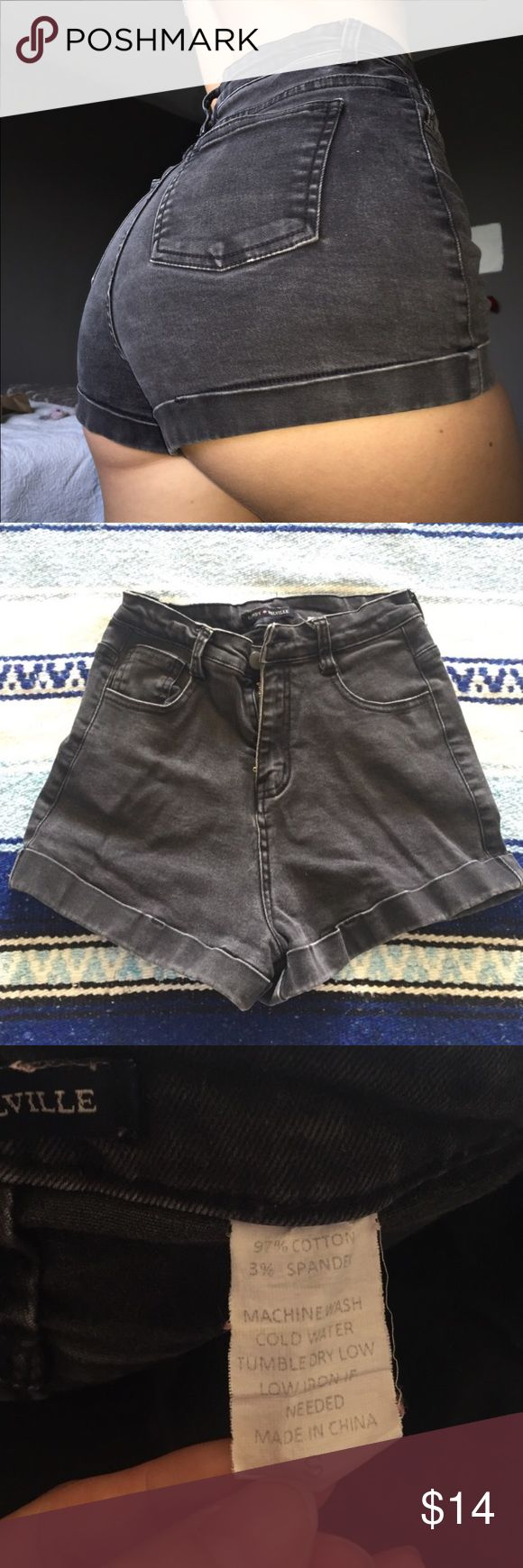 Dark grey stretchy shorts Adorable dark grey brandy shorts! Very stretchy. I don't recommend for people with big butts who don't want cheeks spilling out. Other than that supper comfy!! Can fit 24/25 Brandy Melville Shorts Jean Shorts