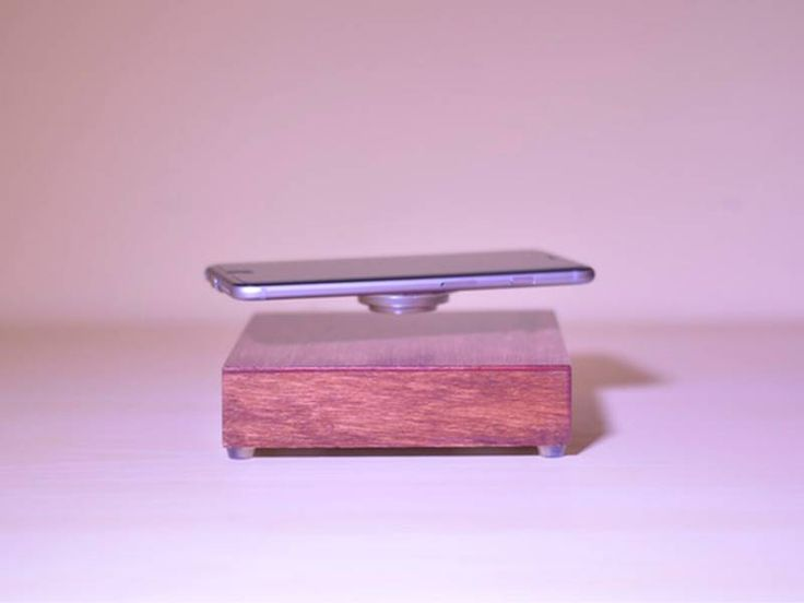 OvRcharge is basically a wooden box with the magnetic levitation and wireless charging technology inside.