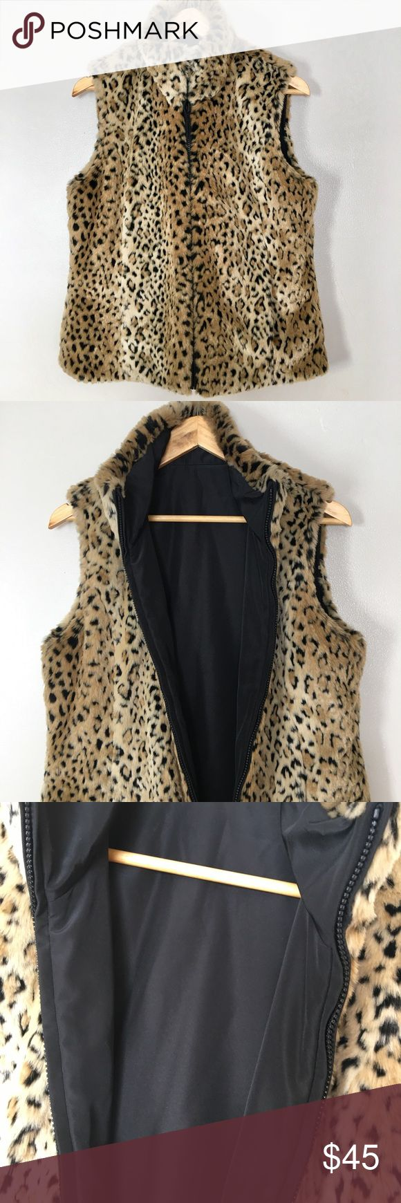 Kristen Blake leopard Reversible Soft Fur Vest Kristen Blake Women's Reversible Soft Fur Animal Print Vest. One side of the vest is a solid color made of 100% Polyester and the other side is a faux fur lining made of 81% Modacrylic and 19% Polyester Reversible zip up front with two zip up front pockets and is reversible Two side pockets (both sides) Tan Leopard: Leopard print/Black lining Kristen Blake Jackets & Coats Vests