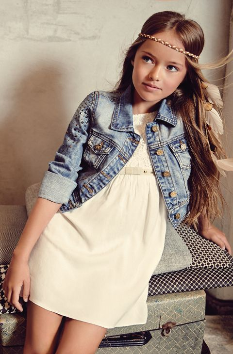 Tween girls style Girls clothing Tween fashion Girls fashion.  Gorgeous dress layered with denim jacket on the beautiful Kristina Pimenova.   The denim jacket is an essential for any wardrobe. Its especially versatile in your tween or teens wardrobe to layer any look keeping it chic and modest