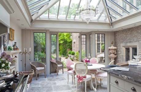 Kitchen conservatory on a period property features bronze casements in the window and door frames with lead detailing. The glazed roof provides lots of light for cooking and entertaining in style. Internal paint is Mud Pie, from Vale's conservatory paint collection.