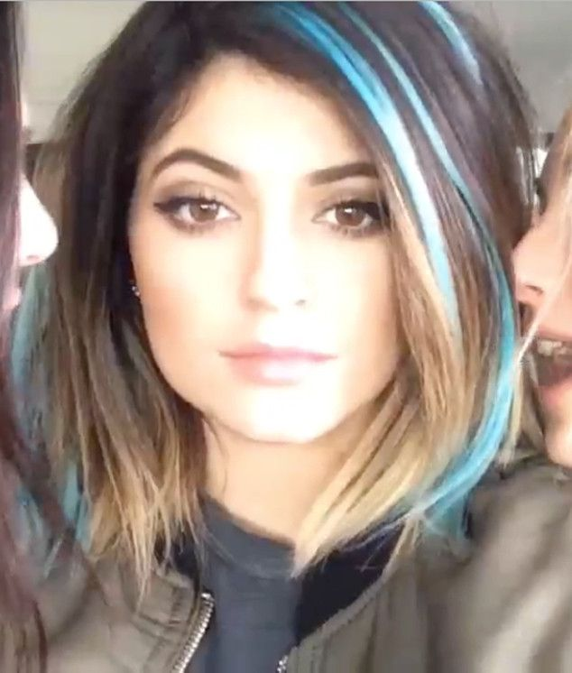 Before she went for the blue ombré, Kylie experimented with playful teal streaks.