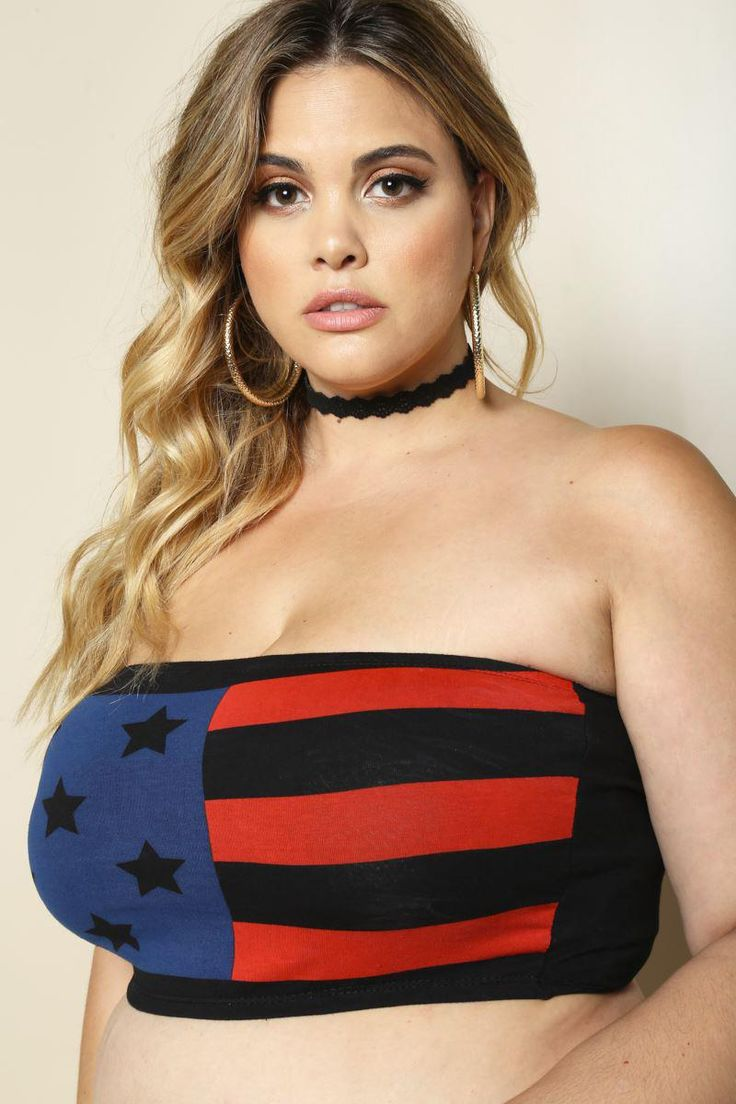 Show off a little in this sultry plus size printed bandeau. Features an Americana-inspired design on a stretchy fabric that shows off your curves in away people will notice. Crafted with a body-hugging fit, elasticized grip at the top, and finished hem. Solid back.