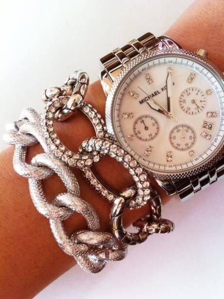 Stacked silver bracelets with Michael Kors watch