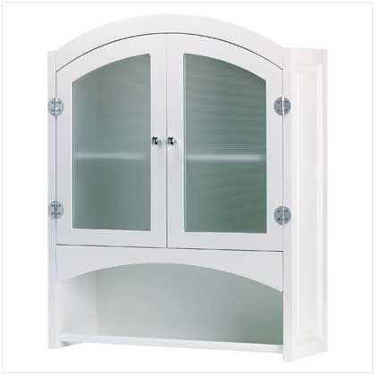 """UPC: #35013 Understated chiffonier elegantly hides bath products and towels behind opaque glass doors.     Silver-finished, magnetic-latch hardware. Wood. Some assembly required. 24 1/3"""" x 9"""" x 30 1/2"""" high. $80 (plus tax/shipping). - to place an order for this product, contact us at asimpletouchgallery@gmail.com"""