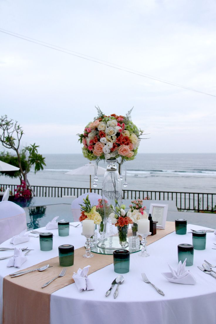 Dining table at main pool Samabe overlooking Indian Ocean