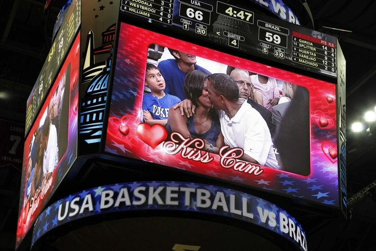 "U.S. President Barack Obama and first lady Michelle Obama are shown kissing on the ""Kiss Cam"" screen during a timeout in the Olympic basketball exhibition game between the U.S. and Brazil national men's teams in Washington, July 16."