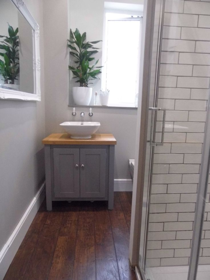 Bathroom. Aspenn furniture. Duravit Bacino. Lancaster taps. Karndean hickory peppercorn. Tileflair blanco tinte matt. Merlyn 8.