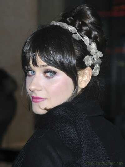 Bangs. And headband. And hairstyle in general.