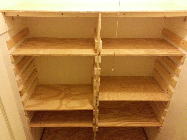 Wood closet organization. Adjustable shelves ...