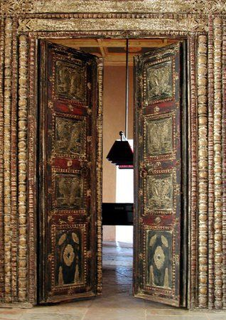 Africa | Door at the Ksar Char Bagh in Marrakesh.