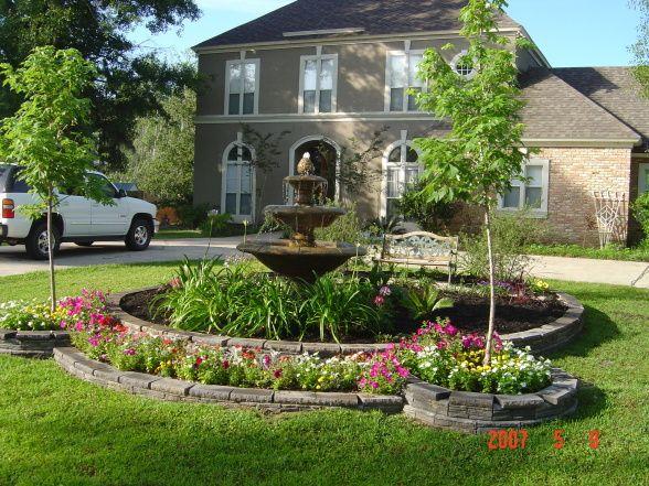 Front yard center garden w fountain after hurricane for Front garden features