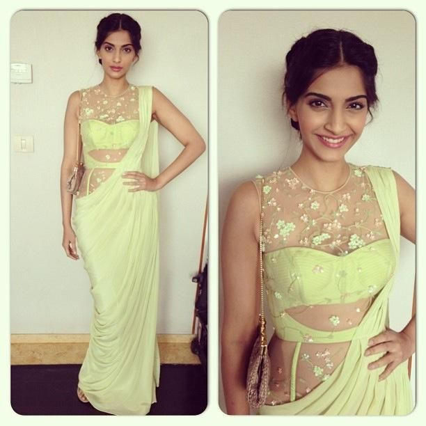 Sonam Kapoor in Sonaakshi Raajat | love this sari! the lace over lay on the entire torso is sexy and modest!