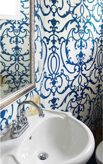 Little room big impact bold paper in the powder room for Blue bathroom wallpaper