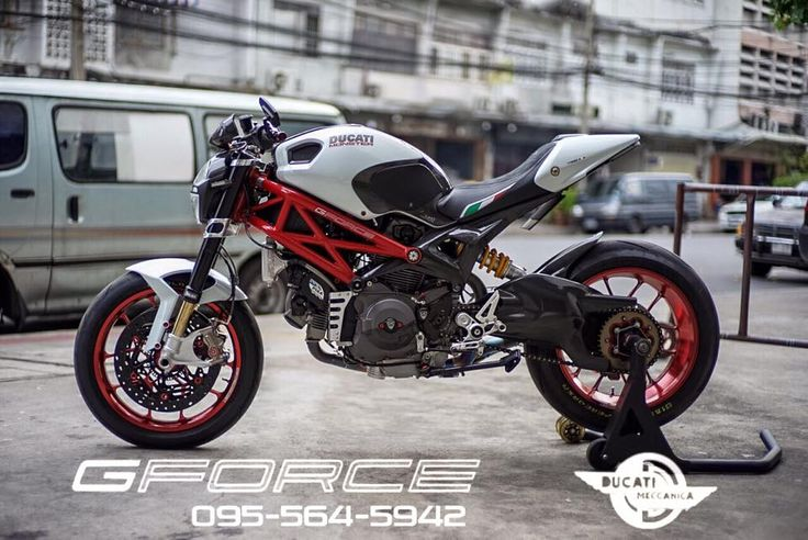 White Ducati Monster with Carrozzeria rims and a low slung 2-1 exhaust