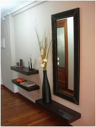 I love the unique shelves and the use of the space. This could replace a console table in the entry way.