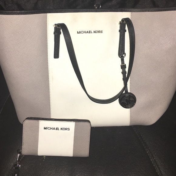 Michael Kors tote & wallet $230 through p.pal Like new.. Worn a couple times thats it. $230 through P.PAL Michael Kors Bags Totes