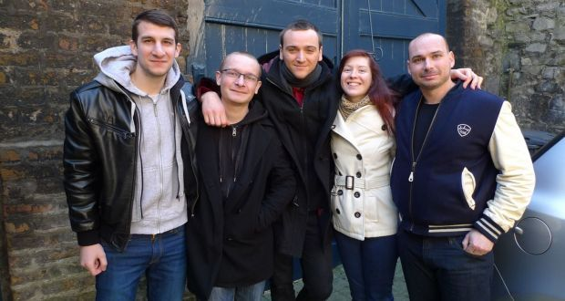 Florian Coulan (c) and friends from France, who fell victim to a sophisticated online accommodation booking scam.
